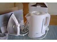 Unused kettle, iron and toaster