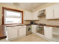 A top floor split level flat offering three bedrooms and a garden, situated on Woodbury Street