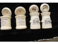4 LITTLE CREAM POTS WITH LIDS ON