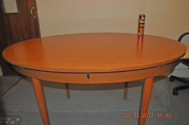 Schreiber oval dining table - extends to 137 x 142