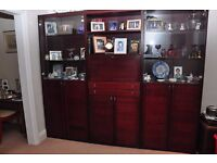 wall unit in wood veneer and glass with pull down drinks cabinet comes in three sections