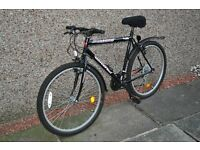 "Gents / Youths Bike. 18 Gears, 26"" Wheels, 21"" Frame, Mudguards, Comfortable ""Gel"" Saddle Cover."