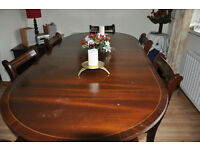 Reproduction dining room table, four chairs and two carvers for sale.