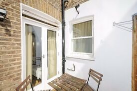 Fairholme Road W14. Furnished studio flat to rent with court yard, Available now.