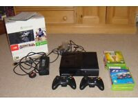 Microsoft 500Gb Black Xbox 360 S with 2 black wireless controllers and 8 games in original box