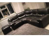 Brown leather corner sofa and footstool