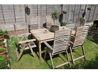 Quality teak garden table and 6 recliner chairs, can deliver locally.