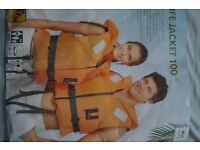 Bright orange adults life jacket in excellent condition (worn only once)
