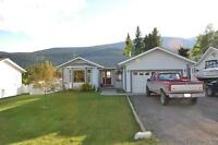 Beautiful home with rental suite beside Golf course.