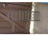 Black wrought metal wine rack