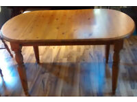 "Pine coloured table Table 54"" length by 36"" wide"