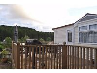 8 berth static caravan with deck area located on corriefodly site perthshire