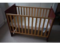 Wooden Cot – Mamas and Papas. Ruby red head/footboard. Adjustable height. VGC.
