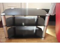 "BLACK GLASS TV UNIT HEIGHT 21"" LENGTH 32"" WIDTH 18"""