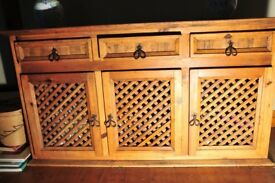 Lovely rustic pine dresser with three doors and lattice fronts. Would look great painted grey too