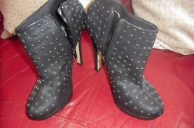"SIZE 7 PAIR BLACK SHOE BOOTS WITH 5"" HEEL THEY HAVE GOLD STUDS ON THEM"