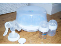 Philips Avent Microwave Steam Steriliser Comes with bottles and breast pump.
