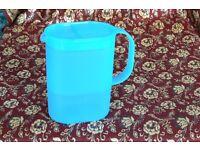 Light blue Tupperware 1ltr. jug.