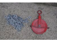 large pulley wheel and chain