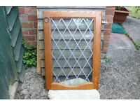 Cupboard doors in wood with leaded glass x 2.