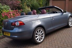 VW EOS, grey metallic with stunning red leather interior