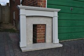 Wooden Fire mantlepiece with marble base and back plate.
