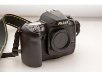 Nikon D100 digital Camera body with 2 Batteries, Battery Charger and Multifunction Battery Pack.
