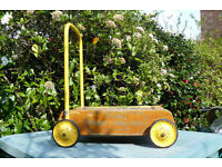 Vintage Triang wooden baby walker with bricks.