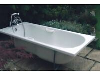 white bath with mixer taps and shower head