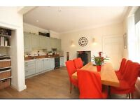 Lovely four bed family house with south facing garden, parking.