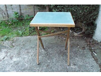 Folding table with green baise top.