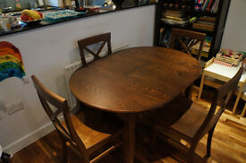 JL Lacock Round Extending Table & Chairs