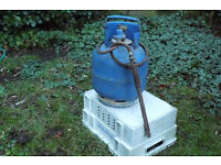 Calor gas 4.5 cylinder with an attachment for lighting barbeques.