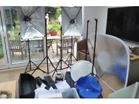 Three Photographic Light Umbrellas, 6 Telescopic stands, 2 Lastolite reflector screens