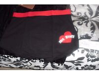 """SIZE LARGE NEW PAIR MEN'S BLACK BOXER SHORTS WITH RED HEART PRINT WITH """"HOT STUFF"""" PRINTED ON"""