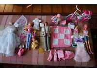 Barbies and accessories including clothes and bike