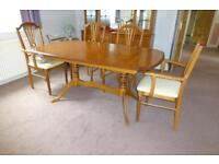 Extending dining table and 6 matching chairs.