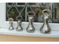 4 VINTAGE GRADUATED STAINLESS STEEL BELL WEIGHTS