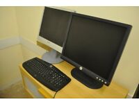 Two computer monitor screens + keyboard - Sony and Dell