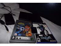 Playstation 2 with 8MB Memory Card and Two Games (missing other end to power supply)