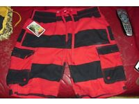 SIZE MEDIUM NEW PAIR OF MEN'S SWIM SHORTS IN RED/BLACK STRIPE