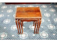 Nest of three glass topped dark wood coffee tables / slender cabriole legs in Queen Anne style.