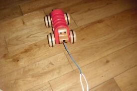 LITTLE WOODEN PULL ALONG TOY WHICH MAKES NOISES