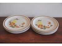 8 large plates with flower design