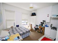 Includes Gas and Water Bills, Generous Studio Flat, Suits Couple Or Single, Close To Tube.