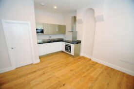 A modern, two bedroom two bathroom flat with patio garden located on Devonshire road