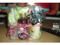 BRAND NEW AVON PAMPPER GIFT SET IN A CLEAR PLASTIC BOX WITH BOW