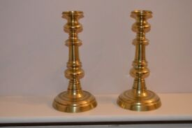 Pair of brass candle sticks with plungers