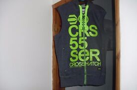 """SIZE MEDIUM """"CROSSHATCH"""" DARK GREY GILLET WITH BRIGHT GREEN WRITING ON FRONT"""