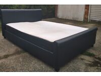 Black King size bed ,no mattress ,can deliver